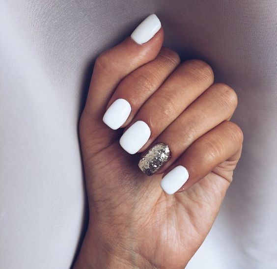 a white manicure with a gold glitter accent nail is a timeless and stylish idea to rock for a winter or other bridal look