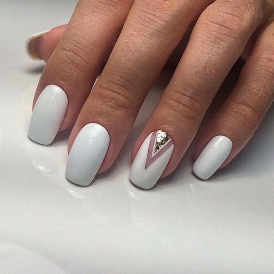 a white manicure with a negative chevron and silver glitter at the base looks amazingly stylish