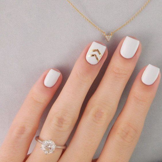 a white manicure with gold leaf chevrons are a timeless and stylish idea to rock for a glam wedding