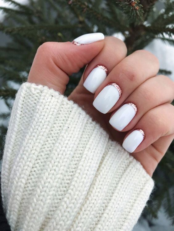 a white manicure with pink glitter touches is a veyr chic and stylish idea to rock in winter