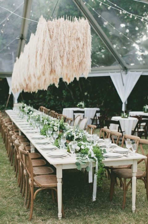 an amazing overhead wedding installation of pampas grass to add an edgy touch