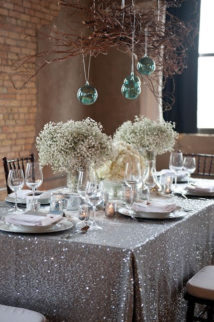 aqua colored ornaments hanging over the wedding reception is a great and very bold idea to try