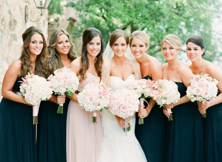 black strapless maxi gowns with draped bodices and a matching blush one for the maid of honor