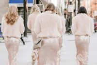 blush fuzzy coats matching blush sequin bridesmaid dresses and creating a tender and trendy look