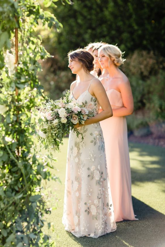 blush strapless maxi dresses for the bridesmaids and a neutral floral maxi dress for the maid of honor