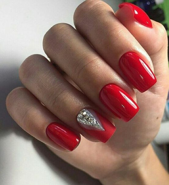 bold red nails with a geometric rhinestone touch for a winter holiday wedding