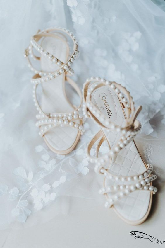 catchy and super glam strappy wedding shoes covered with pearls look very chic and adorable