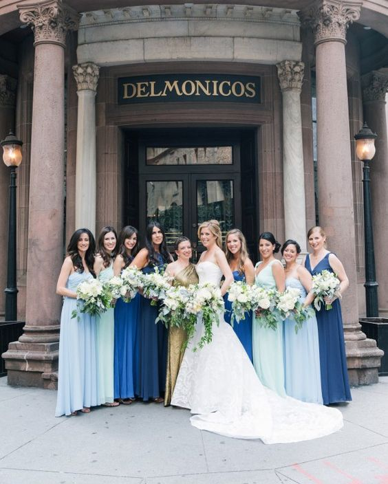 cobalt and light blue plus navy maxi gowns for the bridesmaids and a gold sequin one shoulder maxi dress for the maid of honor