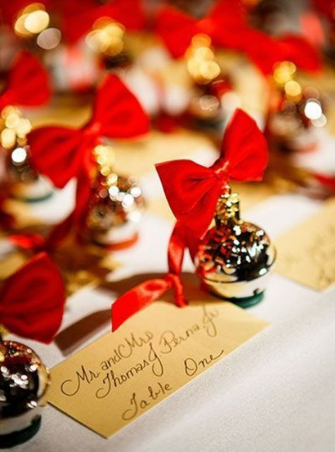 display your escort cards with little ornaments with red bows that will double as favors