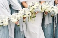 dove grey pashminas with fringe match the blue dresses and keep the girls warm and comfortable