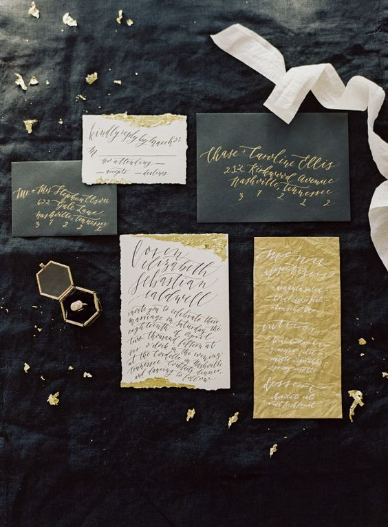 gorgeous black and white wedding stationery with touches of gold and calligraphy