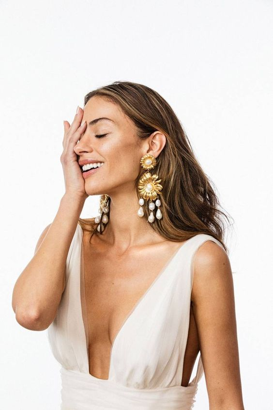 gorgeous statement gold flowers and usual and baroque pearl earrings will make a statement in any bridal look