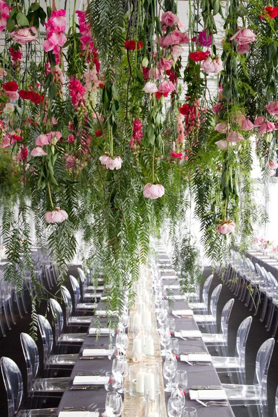 lush foliage, pink and hot pink blooms hanging down make the monochromatic reception pop up with color