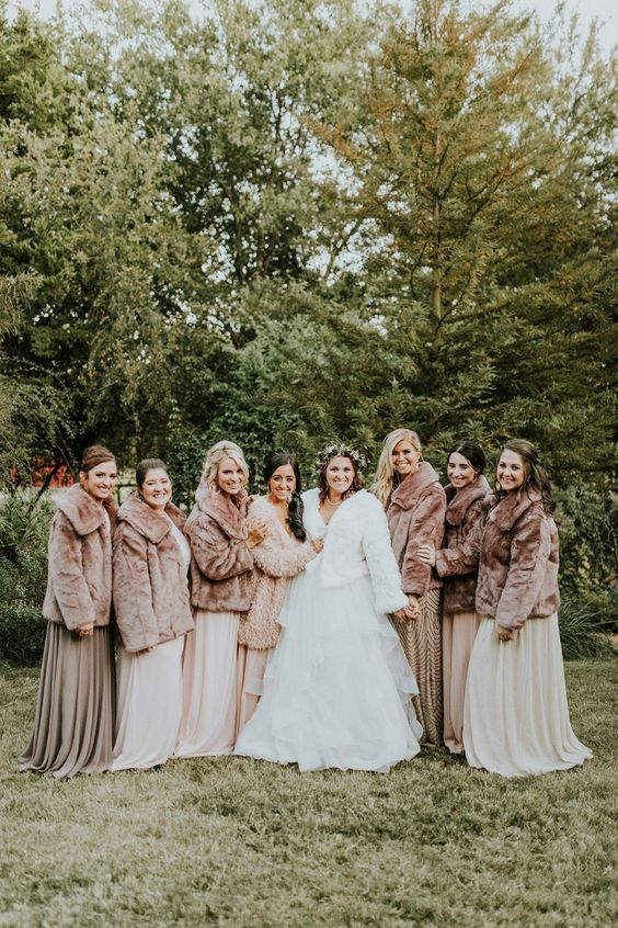 matching faux fur coats will keep your bridesmaids warm during a winter wedding, choose a white one for yourself
