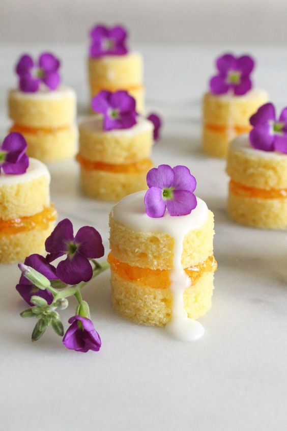 mini naked cakes filled with sweet and tangy orange marmalade and garnished with fresh flowers