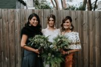 mismatching jewel-tone bridesmaid dresses and mismatching coverups for an ultimately stylish bridesmaid look
