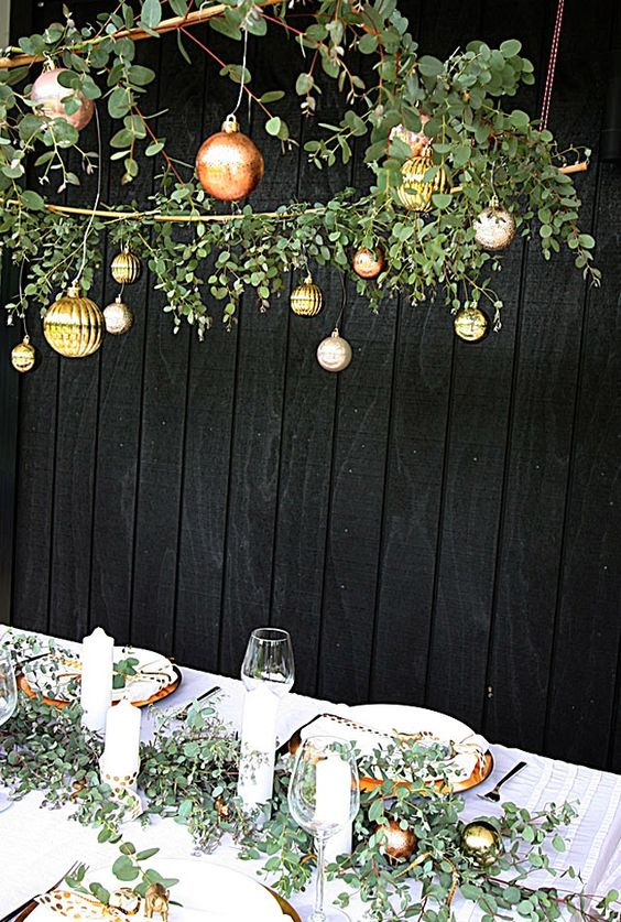 mixed metallic Christmas ornaments over the tablescape and in the table runner make the reception holiday like