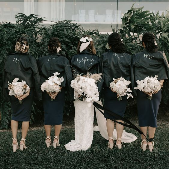 monogrammed black leather jackets for all the gals are a nice idea to cover up with style on the big day