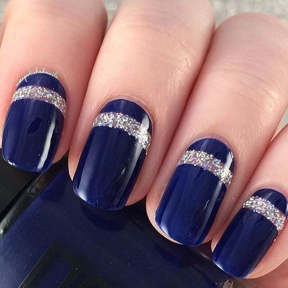 navy and silver glitter wedding nails are a gorgeous idea to incorporate the color scheme