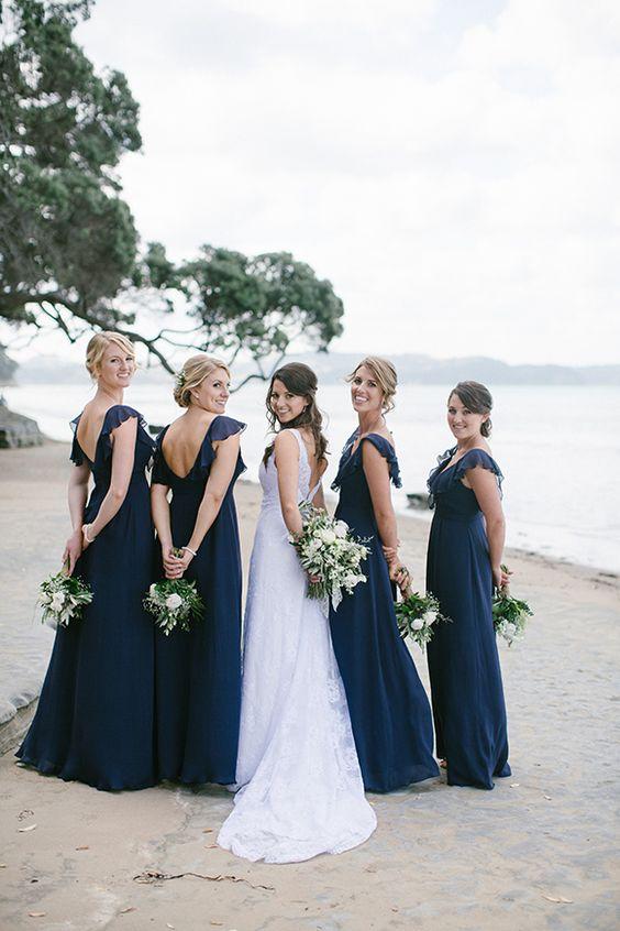 navy maxi bridesmaid dresses with ruffles, no sleeves and cutout backs