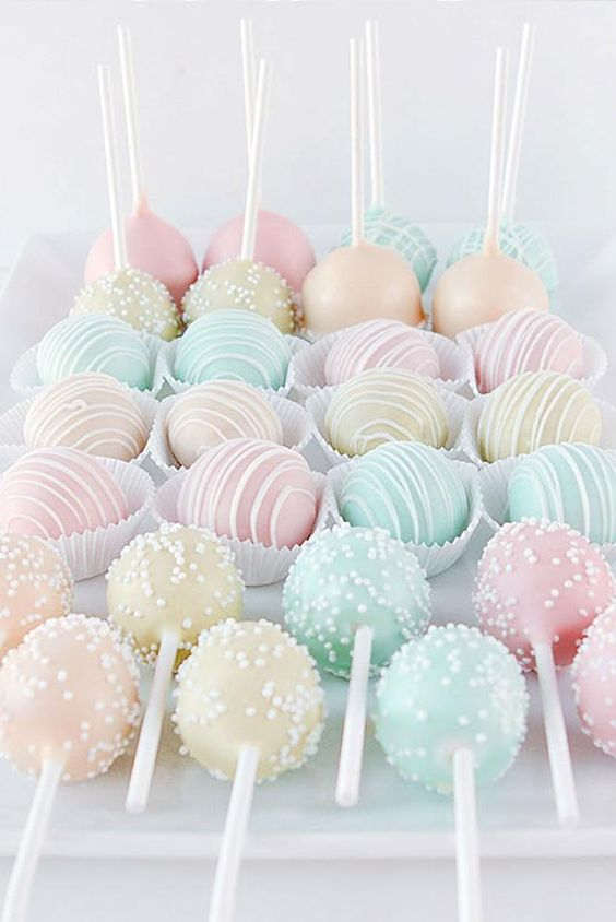 pastel cake pops and mini candies are amazing for a pastel wedding and look delicious