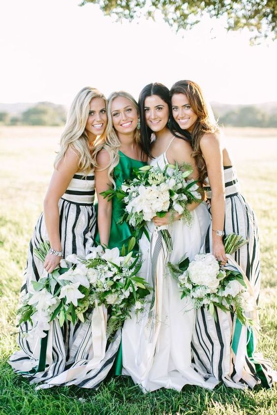 striped maxi gowns in black and white and an emerald one shoulder maxi dress for the maid of honor
