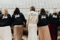 stylish and comfy bomber jackets – black for bridesmaids and a white one for the bride are a creative option