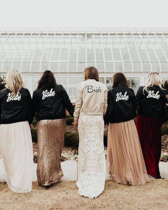 stylish and comfy bomber jackets - black for bridesmaids and a white one for the bride are a creative option