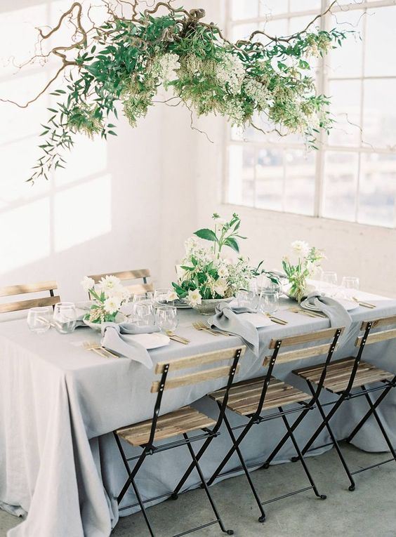 such a natural greenery, branch and white bloom wedding installation is a great idea for a garden feel indoors