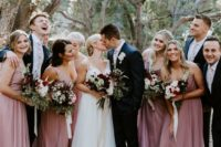 thick strap mauve maxi bridesmaid dresses with V-necklines and draped bodices for a summer wedding