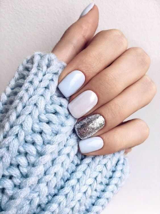 white and light blue and silver gltiter nails are beautiful for a chic winter bridal look