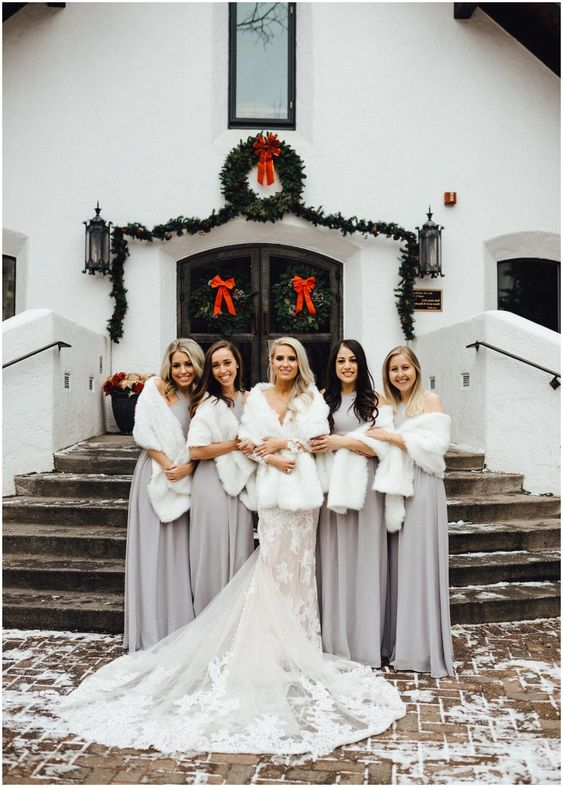 white faux fur shawls add chic to the snowy bridesmaid looks, make the outfits more chic and stylish
