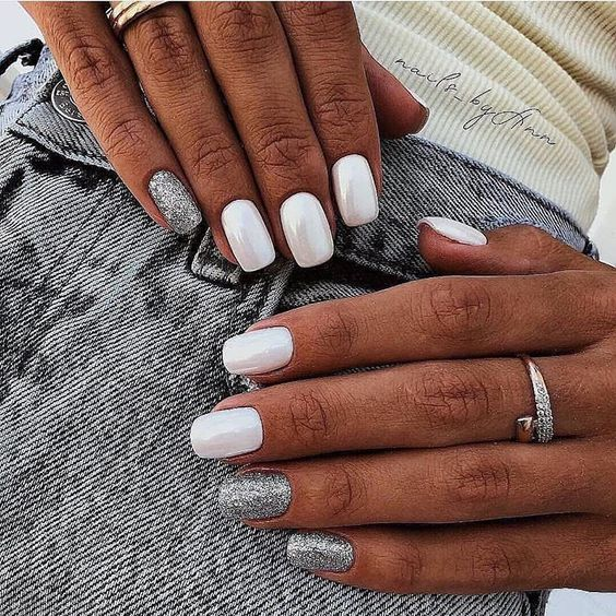 white mother of pearl and grey glitter nails look very shiny, glam and chic and make your look special