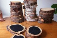 wood slices with a live edge and chalkboard paint is a cool idea as a fall wedding guest book to sign up