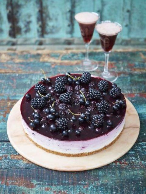 a black currant ombré cheesecake topped with fersh currant and blackberries is a decadent dessert that will make you excited