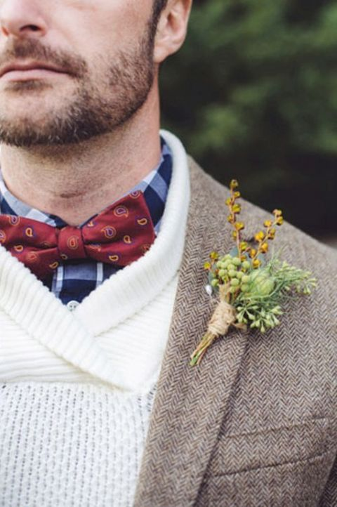 a blue plaid shirt, a white sweater, a tweed blazer and a red printed bow tie for a cozy and lovely winter groom's look