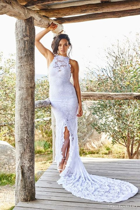 a boho lace sheath wedding dress with an illusion halter neckline, a front slit and a train for a boho bride