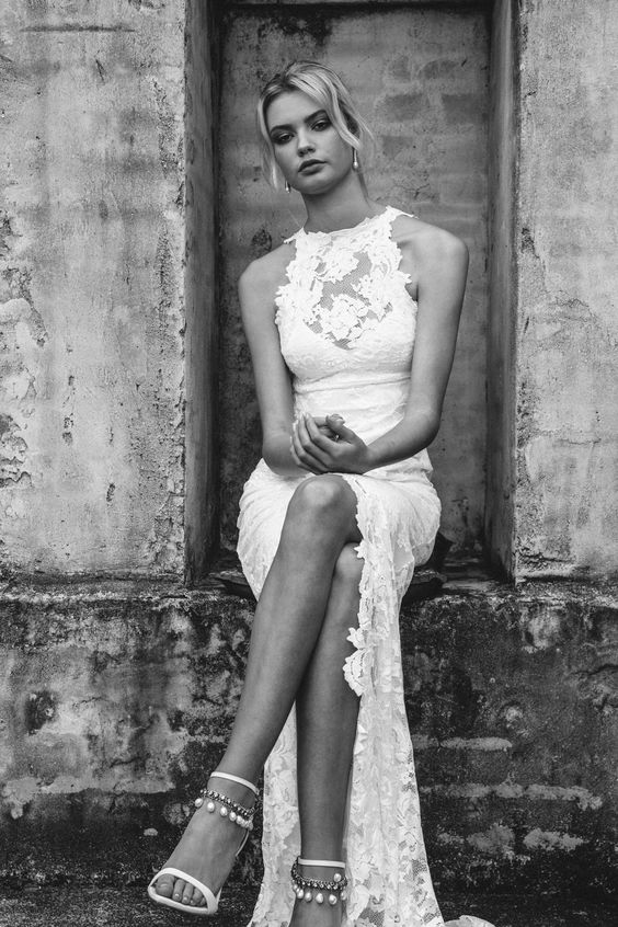 a chic lace halter neckline wedding dress with a front slit and a train for a boho or gypsy bride