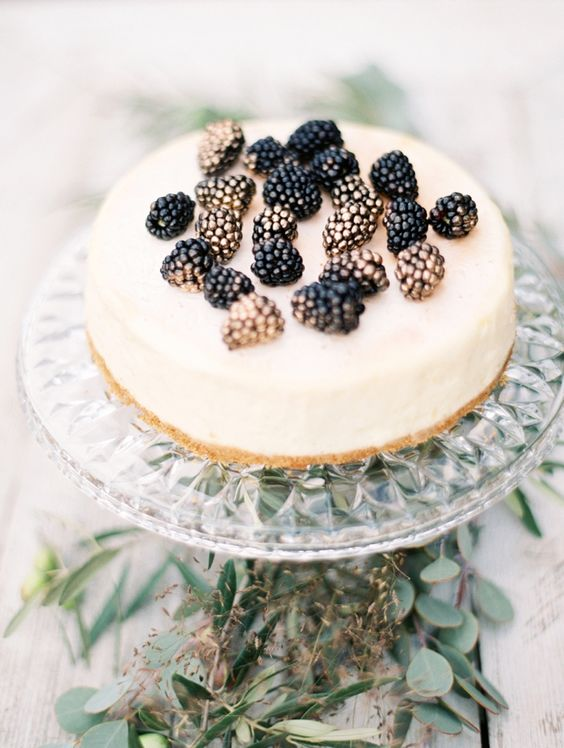 a classic cheesecake topped with gilded blackberries is a yummy dessert that always works