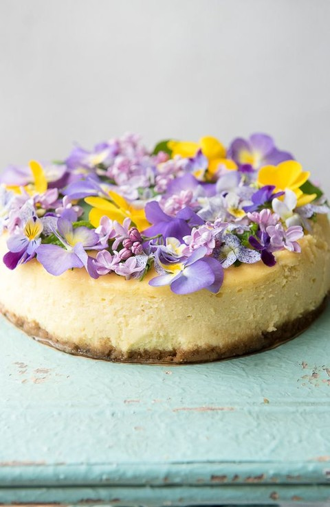 a creamy lemon cheesecake with vanilla wafer crust topped with fresh blooms is a cool idea for summer
