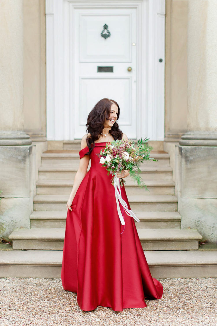 a fantastic red off the shoulder A-line wedding dress will stand out in pale winter locations