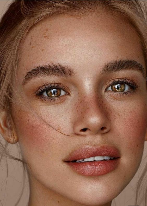 a gorgeous sun-touched look with a shiny pink lip, accented eyes and coral blush, a bit of bronzer and edgy eyebrows