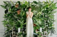 a green wall made of various tropical leaves and ferns for a tropical feel wherever you are