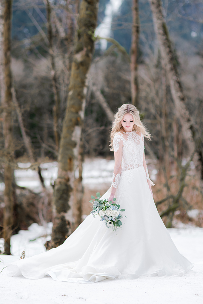 a lace illusion bodice and sleeve A line wedding dress with a train for a princess style look