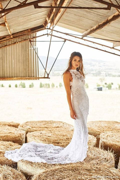 a lace sheath wedding dress with an illusion halter neckline and a train for a romantic modern bride