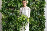 a living wall backdrop and a matching bridal bouquet to bring an outdoor feel indoors