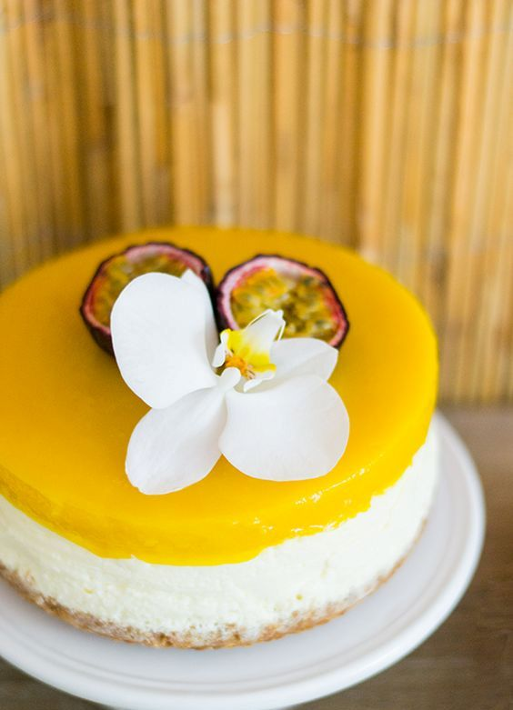 a mango cheesecake with fresh tropical fruit and a single white bloom is a gorgeous idea for a tropical wedding