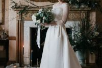 a romantic A-line wedding dress with a lace bodice, illusion sleeves and a neckline plus a high low skirt with a train