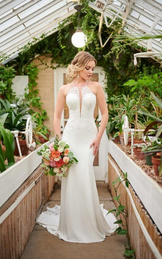 a sexy sheath wedding dress with a lace halter neckline bodice and a plain skirt with a train
