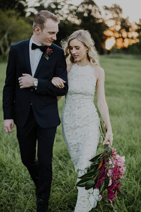 a sheath boho lace wedding dress with a halter neckline and an accented waist looks very modern and chic